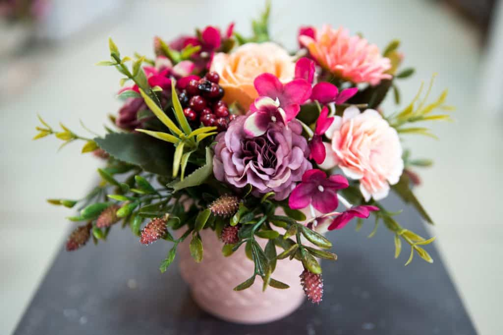 peach violet and pink assorted flowers in vase